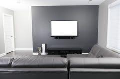 Salone grigio e bianco con il supporto ed il sofà della TV immagini stock