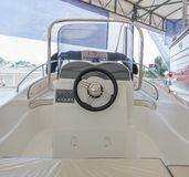 Salone Nautico - close up of the captain seat with controllers for a motor boat. Salone Nautico is an international federation boat show that puts in exposition Royalty Free Stock Photo