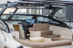 Inside of luxury sport Yacht. Salone Nautico in Genova, Italy 2017. On display big modern luxury white yacht. Interior of a commercial yacht Royalty Free Stock Image