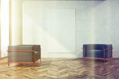 Salone, poltrone blu, manifesto tonificato Fotografia Stock