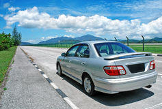 Saloon car on the road Royalty Free Stock Photos