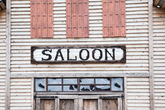 Saloon iscription on wooden building facade Royalty Free Stock Images