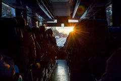 Free Saloon Of Bus With Passengers. The Light Of The Sun Penetrates Stock Images - 129747624