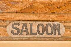Saloon Sign. With letters on wood hanging in a ghost town Royalty Free Stock Images