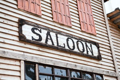 Saloon sign on building facade. Nobody Royalty Free Stock Images