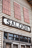 Saloon sign on western wooden building. Nobody Royalty Free Stock Photo