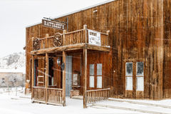 Saloon in snow flurries Stock Images
