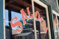 Saloon window. Closeup of word saloon on barroom window Stock Photo