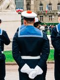Salor mariner at pArade in France rear view unrecognizable. Rear view of unrecognizable sailor mariner at ceremony to mark Western allies World War Two victory stock photo