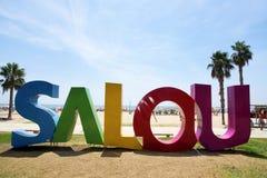 Salou firma dentro la spiaggia di Llevant, a Salou, la Spagna Fotografia Stock Libera da Diritti