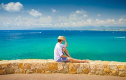 Salou resort. Costa dorada coastline. Young man enjoying summer sea view. Man on blue sea and clear sky background Stock Images