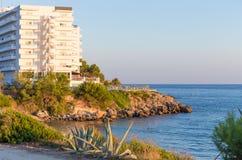 Salou resort. White hotel on seaside on blue sky background. Summer in Spain Royalty Free Stock Image