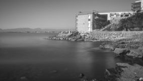 Salou, Tarragona. B/W hotel building in front of the silky water stock photo