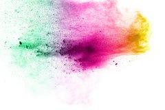 Salpicadura multicolora abstracta del polvo en el fondo blanco Foto de archivo