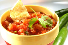Salsa. Homemade salsa in bowl with peppers