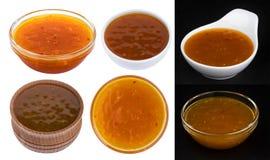 Salsa agridulce anaranjada aislada en el fondo blanco colección foto de archivo