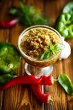 Salsa aguda del adzhika de diversos tipos de pimienta Fotografía de archivo
