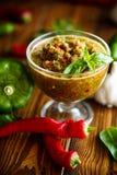 Salsa aguda del adzhika de diversos tipos de pimienta Foto de archivo libre de regalías