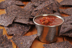 Salsa and blue corn chips Royalty Free Stock Photos