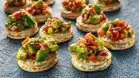 Salsa canape cracker appetizers with soft cheese Stock Images