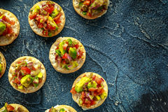 Salsa canape cracker appetizers with soft cheese Royalty Free Stock Photo