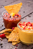 Salsa- and Cheese Sauce on wooden background Royalty Free Stock Photos