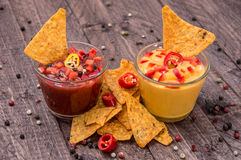 Salsa- and Cheese Sauce on wooden background Royalty Free Stock Image