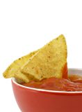 Salsa and chips. Close-up isolated on white background royalty free stock image