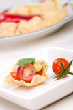 Salsa and chips. Corn tortilla chips fill with fresh cherry tomatoes salsa stock image