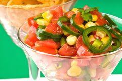 Salsa Closeup. Closeup of homemade spicy salsa in a glass royalty free stock photography