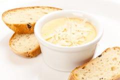Salsa con queso y pan Fotos de archivo libres de regalías