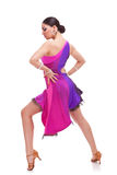 Salsa dancer with hands on hips. Full length picture of a gorgeous salsa woman dancer posing with hands on hips royalty free stock image