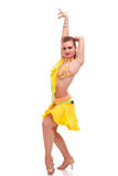 Salsa dancer posing in a yellow dress Stock Photography