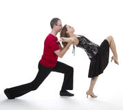 Salsa dancers. Couple dancing salsa in the middle of a pose Stock Photo