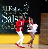 Salsa dancers in Internacional Festival of Salsa in Cali, Colombia red couple. End of the dancing royalty free stock images