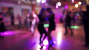 Salsa dancing in a latin dance club, blurry