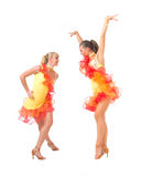 Salsa dancing. Two female salsa dancers in colorful dresses over white background stock photography