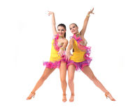 Salsa dancing. Two female salsa dancers in colorful dresses over white background stock photos