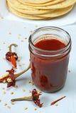 Salsa de chile roja Imágenes de archivo libres de regalías