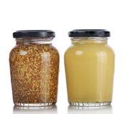 Salsa de mostaza y mostaza entera del grano Fotos de archivo