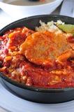 Salsa de tomate cocida del cerdo Fotografía de archivo