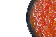 Salsa de tomate en la placa negra Imagen de archivo libre de regalías