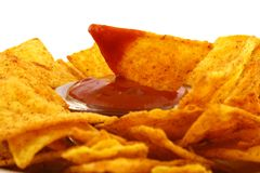 Salsa dip. In a bowl on brown background royalty free stock photos
