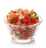 Salsa dip. Bowl of fresh salsa dip isolated on white background stock photo