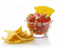 Salsa dip. Bowl of salsa dip and nachos isolated on white background Stock Images