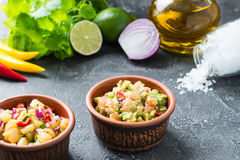 Salsa and guacamole dips with ingredients. Mexican cuisine concept Royalty Free Stock Photography