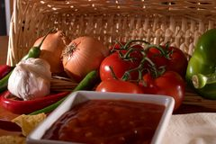 Salsa and ingredients basket Stock Photos