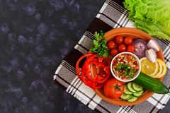 Salsa with ingredients on dark background. Top view.  stock images