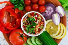 Salsa with ingredients on white background. Top view.  stock image