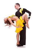 Salsa male dancer holding his partner. In a leaning pose while dancing Stock Photography